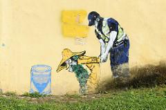 Wandmalerei Edward von Lõngus; Stencil-Graffit in Tartu - Cannabeard und Hexenjäger / Kannahabe ja nõiakütt.