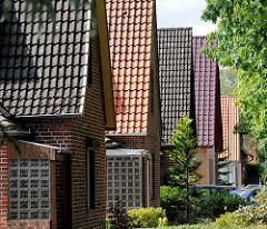 Siedlungshäuser - Einzelhäuser mit Spitzdach / Satteldach in Schneverdingen.