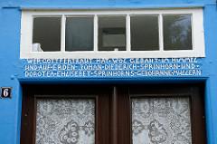 Historischer Türsturz mit geschnitzter Inschrift; Bibelspruch und Namen Springhorn - Rosenstraße in Soltau.
