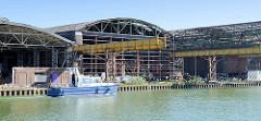 Abriss der Osmo-Hallen am Hafen von Münster; ehem. Holzlager / Industriebrache - geplanter Neubau eines Bürogebäudes.