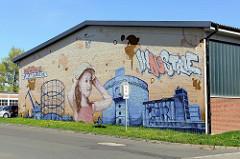 Fassadenmalerei einer Firma am Industrieweg in Münster.
