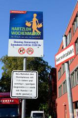 Informationsschild vom Bezirksamt Hamburg Nord, Hartzloh Wochenmarkt - so frisch, so nah, so herzlich.