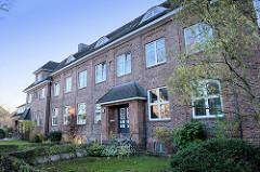 Siedlungsbau im Finksweg von Hamburg Finkenwerder, das Baudenkmal wurde 1921 errichtet - Architekt J. F. Dethlefs.