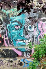Graffiti an den Kaimauern des Donaukanals in Wien.