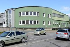 Fotos  aus dem Hamburger Stadtteil Rothenburgsort - Bezirk Mitte. Verwaltungsgebäude mit grüner Blechfassade - Industriearchitektur in der Grossmannstraße.
