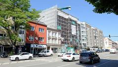 Bilder aus dem Hamburger Stadtteil Hoheluft West, Bezirk Hamburg Eimsbüttel. Neubauten, Wohnhäuser entstehen an der Hoheluftchaussee - Straßenverkehr auf einer der Hauptverkehrsstraße Hamburgs.