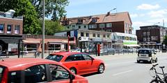 Bilder aus dem Hamburger Stadtteil Hoheluft Ost - Bezirk Hamburg Nord. Flachbauten / provisorische Nachkriegsgebäude - Geschäfte an der Hoheluftchaussee, Autoverkehr.