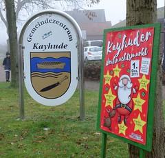 Ankündigungsplakat für den Kayhuder  Weihnachtsmarkt - Gemeindezentrum mit Wappen.