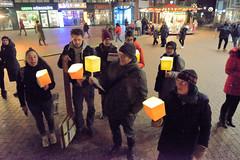 XR-Weihnachtsmarktsingen, Antikonsum-Chor auf dem Weihnachtsmarkt in Hamburg Niendorf.
