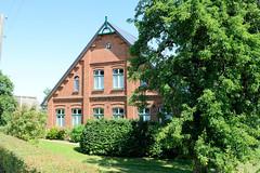 Fotos aus dem Hamburger Stadtteil Altengamme, Vierlande - Bezirk Hamburg Bergedorf. Historisches, unter Denkmalschutz stehendes Wohnwirtschaftsgebäude am Altengammer Hausdeich.