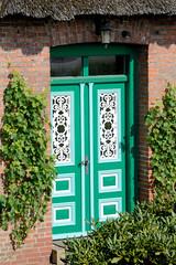 Fotos aus dem Hamburger Stadtteil   Allermöhe, Bezirk Hamburg Bergedorf; Eingangstür.