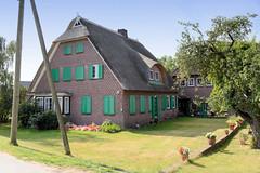 Fotos aus dem Hamburger Stadtteil Reitbrook, Bezirk Bergedorf. Wohnwirtschaftsgebäude am Vorderdeich; das denkmalgeschützte Haus wurde 1943 errichtet, Architekt Bruno Wieck.