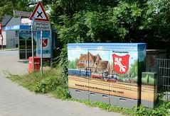 Neuengamme  ist ein Hamburger Stadtteil im Elbmarsch-Gebiet der Vierlande im Bezirk Bergedorf. Mit dem Bild vom historischen Bahnhof Curslack-Neuengamme verzierter Verteilerkasten.