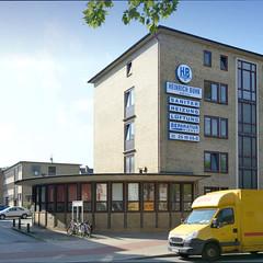 Fotos aus dem Hamburger Stadtteil Borgfelde, Bezirk Hamburg Mitte; Wohn- und Geschäftshaus mit gelber Klinkerfassade und halbrundem Vorbau in der Bürgerweide.