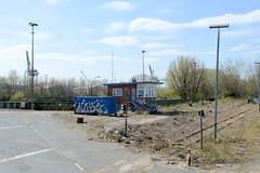 Bilder aus dem Kleinen Grasbrook, Stadtteil in Hamburg -  Übersee Zentrum; Backsteinhäuschen und Bahnschienen am Veddelhöft.