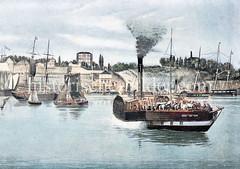Dampffähre mit Schaufelrad - Pferde und Menschen an Bord - Überfahrt von den St. Pauli Landungsbrücken über die Elbe.