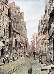 Alte Wohnhäuser / Geschäftshäuser in der Straße Binnenkajen in der Hamburger Altstadt ca. 1870; schmale Gasse mit Prellsteinen, Handkarren und Rinnstein in der Straßenmitte.