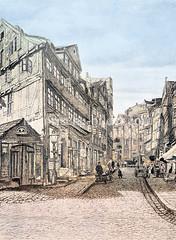 Blick in die Fuhlentwiete in der Hamburger Altstadt, ca. 1880 - hohe Fachwerkhäuser, Kopfsteinpflaster; Handkarren am Straßenrand.