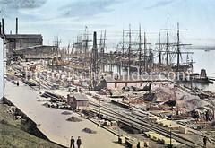 Bau einer Kaianlage im Altonaer Hafen - Baustelle mit Baumaterialien, Segelschiffe / Frachtsegler im Hintergrund (ca. 1880).